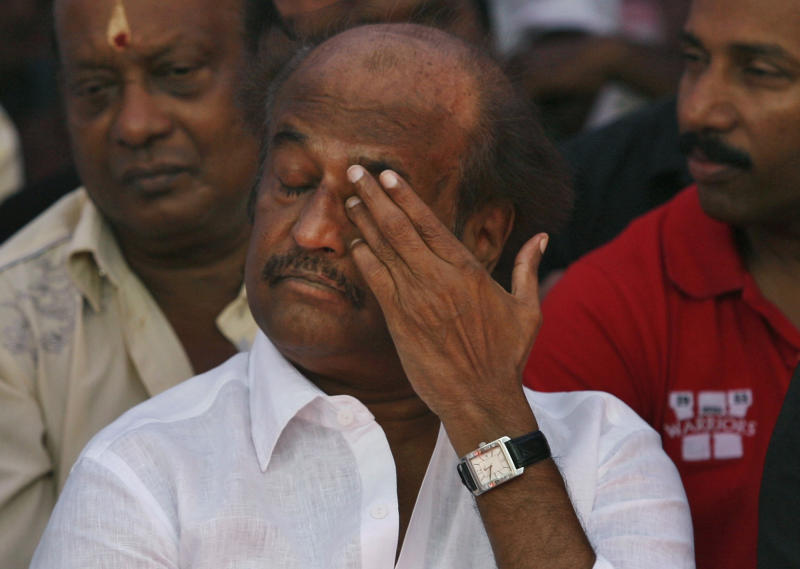 Indian Tamil superstar Rajnikanth gestures as he sits with other Tamil movie stars during a day long fast in Chennai, India, Tuesday, April 2, 2013, demanding probe into alleged wartime abuses by Sri Lanka. The stars are fasting for a day to protest what they say is the mistreatment of ethnic Tamils in neighboring Sri Lanka and to demand an international probe into alleged wartime abuses there. A U.N. investigation into the final months of the war indicated that the ethnic Sinhalese-dominated government might have killed as many as 40,000 Tamil civilians. (AP Photo/Arun Sankar K)