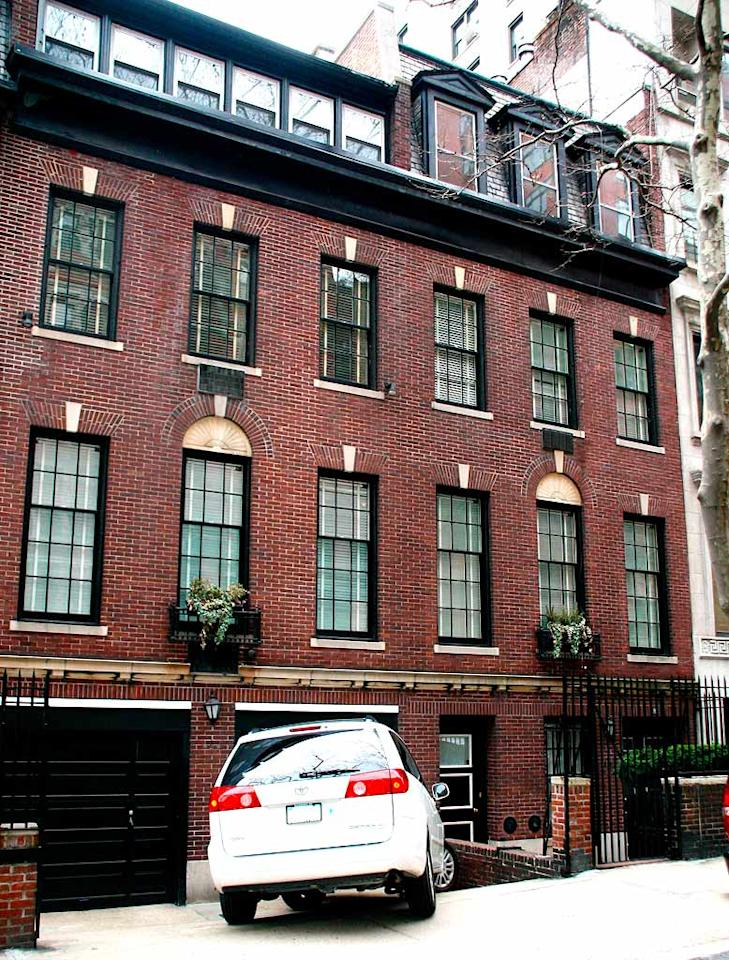 """Take a peek at Madonna's new manse. Madge's Upper East Side, Georgian-style townhome boasts 4 stories, 13 bedrooms, 9 fireplaces, a 3,000 square foot garden, a library, a drawing room, a wine cellar, a grotto, an elevator, maids' quarters, and a whopping $40 million price tag. Perfect for a Material Girl. <a href=""""http://www.x17online.com"""" target=""""new"""">X17 Online</a> - April 14, 2009"""