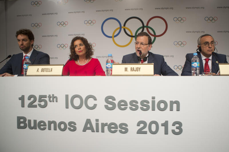 Spain's Olympic bid Committee President Alejandro Blanco, right, Spain's Prime Minister Mariano Rajoy, second from right, Madrid's Mayor Ana Botella, third from right, and NBA player Pau Gasol give a news conference after making their bid presentation in Buenos Aires, Argentina, Saturday, Sept. 7, 2013. Madrid, Istanbul and Tokyo are competing to host the 2020 Summer Olympic Games. (AP Photo/Victor R. Caivano)