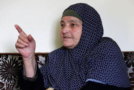 Kamleh Daqamseh, mother of Ahmad Daqamseh, the Jordanian soldier convicted of killing seven Israeli schoolgirls on March 13, 1997, speaks to the media after the release of her son from prison, at her home in the village of Ibdir, Jordan March 12, 2017.  REUTERS/Muhammad Hamed