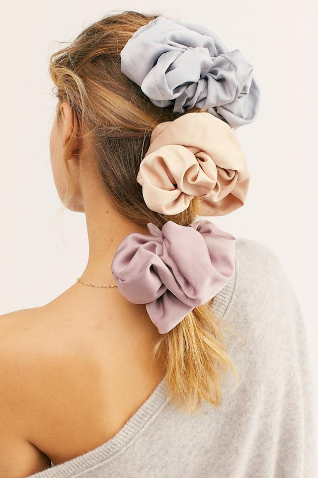 "<p>If they love hair accessories, get this <a href=""https://www.popsugar.com/buy/Super-Scrunchie-516235?p_name=Super%20Scrunchie&retailer=freepeople.com&pid=516235&price=12&evar1=savvy%3Aus&evar9=46982562&evar98=https%3A%2F%2Fwww.popsugar.com%2Fsmart-living%2Fphoto-gallery%2F46982562%2Fimage%2F46982572%2FSuper-Scrunchie&list1=shopping%2Cgifts%2Choliday%2Cgift%20guide%2Cgifts%20under%20%2425&prop13=mobile&pdata=1"" rel=""nofollow"" data-shoppable-link=""1"" target=""_blank"" class=""ga-track"" data-ga-category=""Related"" data-ga-label=""https://www.freepeople.com/shop/super-scrunchie/?category=gifts-stocking-stuffers&amp;color=053"" data-ga-action=""In-Line Links"">Super Scrunchie</a> ($12).</p>"