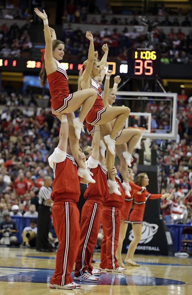 Wisconsin cheerleaders during the second half in a regional final NCAA college basketball tournament gameagainst Arizona, Saturday, March 29, 2014, in Anaheim, Calif. (AP Photo/Alex Gallardo)