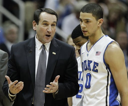 Duke head coach Mike Krzyzweski speaks as guard Austin Rivers (0) during the first half of an NCAA college basketball game in the semifinals of the Atlantic Coast Conference tournament against Florida State, Saturday, March 10, 2012, in Atlanta. (AP Photo/Chuck Burton)