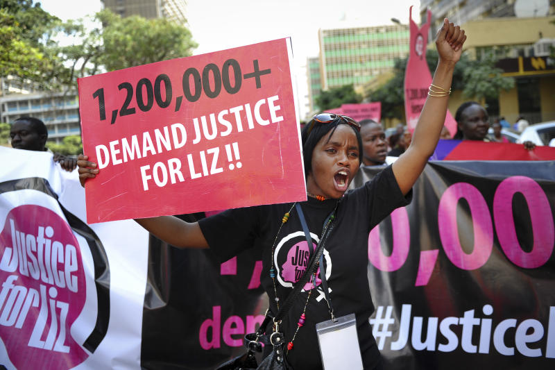 FILE - In this file photo of Thursday, Oct. 31, 2013, women protest after a teenager was allegedly gang-raped in June, in the capital Nairobi, Kenya. A wave of outrage has grown in Kenya over the last couple of weeks. Nearly 1.4 million people have signed an online petition put up by the activist group Avaaz calling for prosecution of the attackers and an investigation of the police who freed the suspects. A 16-year-old girl now confined to a wheelchair is helping shine a light on what activists say is a largely hidden crime in this East African country: rape. (AP Photo/File)