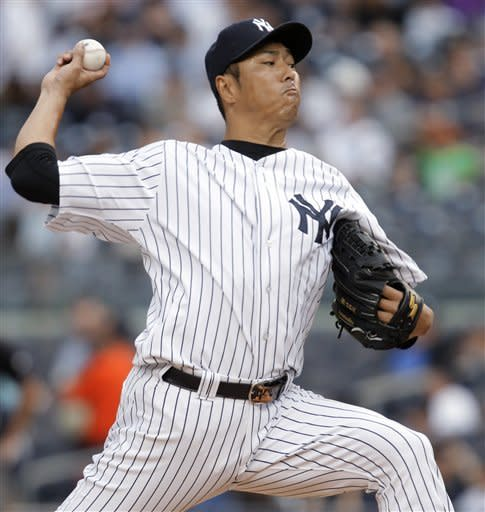 New York Yankees starting pitcher Hiroki Kuroda delivers in the first inning against the Cleveland Indians during a baseball game at Yankee Stadium in New York, Monday, June 25, 2012. (AP Photo/Kathy Willens)