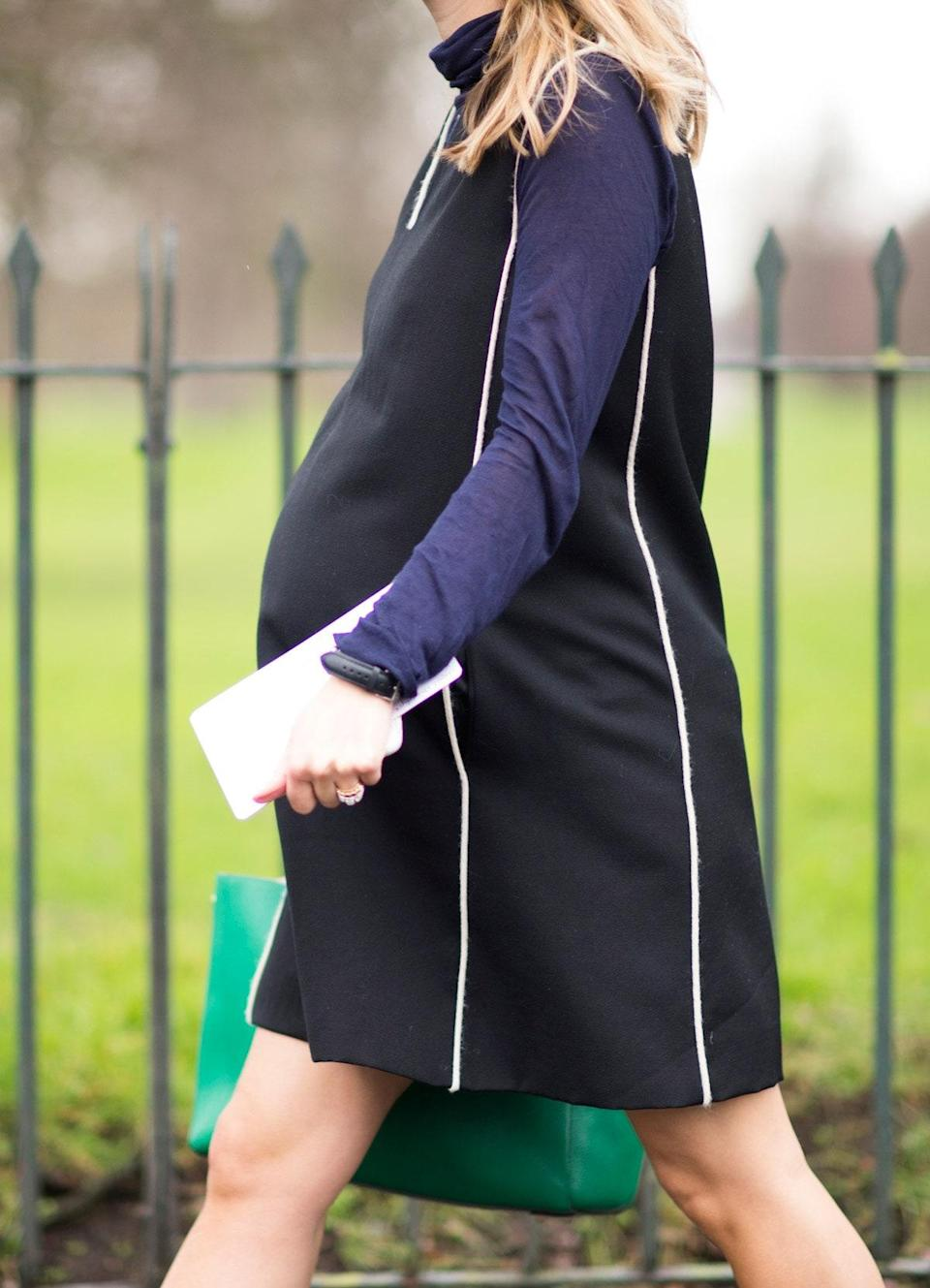 """At seven or eight months in, consider creating a mini """"pregnancy closet"""" out of everything in your wardrobe. """"At a certain point, it just doesn't feel good to have to go through your closet and find what still fits or what doesn't look good; it's frustrating!"""" says Dueñas Jacobs. """"Figure out what works for you, and just ride it out. It was so much easier for me get dressed by only looking at 30 pieces. It's a little like living out of a suitcase."""" Sanchez Lincoln recommends developing a uniform; hers """"consisted of maternity leggings—find some that are really comfortable and have a full panel—and nice, solid maternity T-shirts or blouses that I could dress up or down,"""" as well as accessories and versatile <a href=""""https://www.glamour.com/gallery/35-chic-fall-jackets-and-light-winter-coats-shop?mbid=synd_yahoo_rss"""" rel=""""nofollow noopener"""" target=""""_blank"""" data-ylk=""""slk:jackets"""" class=""""link rapid-noclick-resp"""">jackets</a>."""