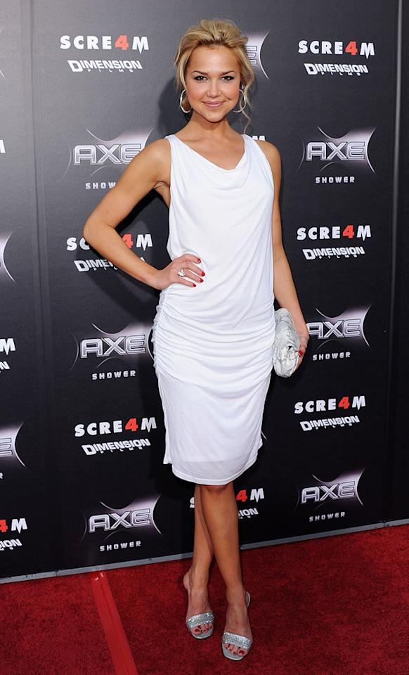 """<a href=""""http://movies.yahoo.com/movie/contributor/1808521783"""">Arielle Kebbel</a> -- who's appeared in horror films such as """"The Grudge 2"""" and """"The Uninvited"""" -- oozed glamour in a ruched white sheath, silver sandals, and loose updo."""