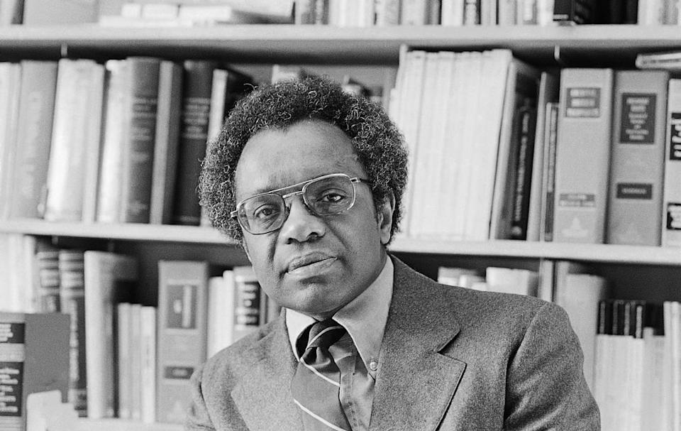FILE - Professor Derrick Bell of the University of Washington Law School shown in his office in this Jan. 30, 1980 file photo. Derrick Bell, a civil rights scholar and writer who was the first tenured black professor at Harvard Law School, died Wednesday Oct. 5, 2011. He was 80. Bell died Wednesday night of carcinoid cancer at a Manhattan hospital, his wife, Janet Dewart Bell, said Friday. (AP Photo, File)