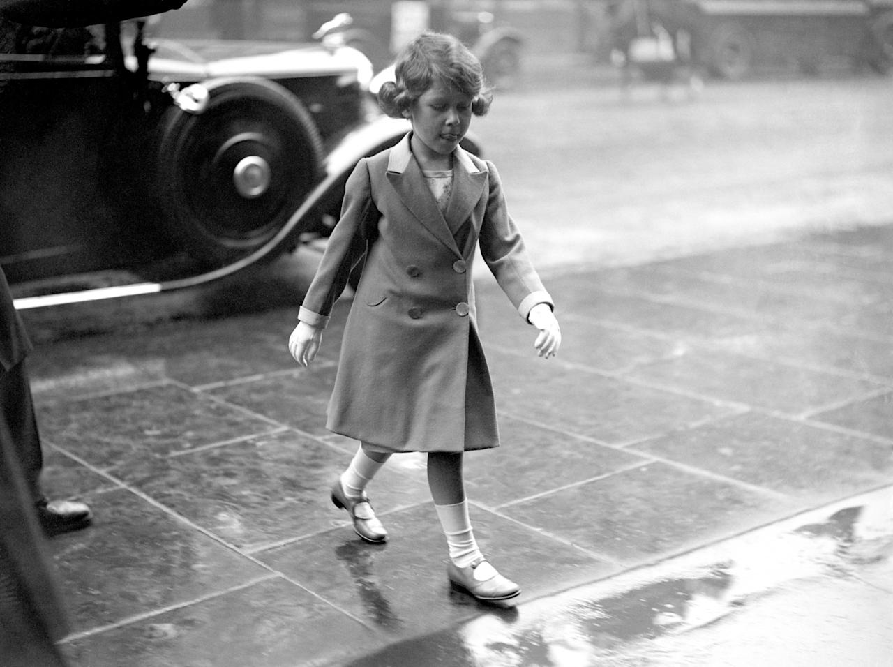 <p>A young princess walks through the rain in London (PA Archive) </p>