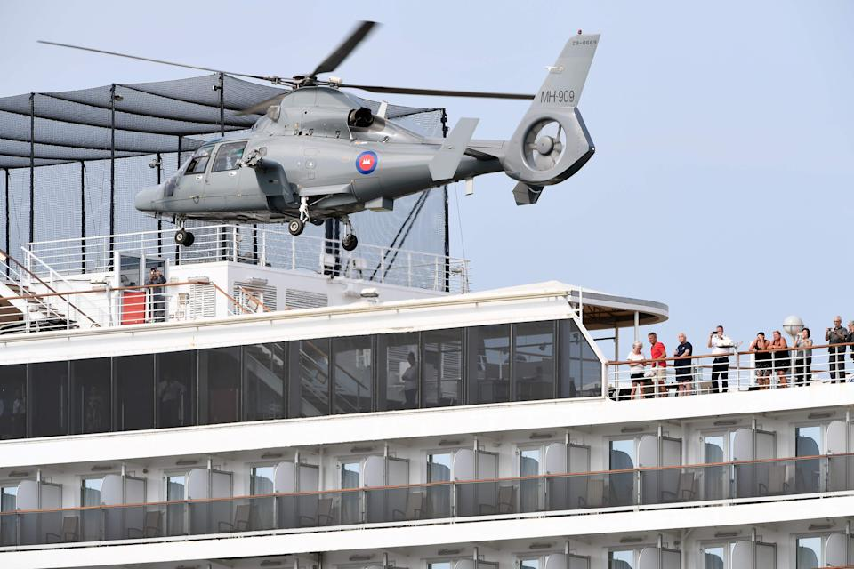 A helicopter takes off from the MS Westerdam Tuesday after Cambodian health officials checked to see whether any remaining passengers have the COVID-19 coronavirus.