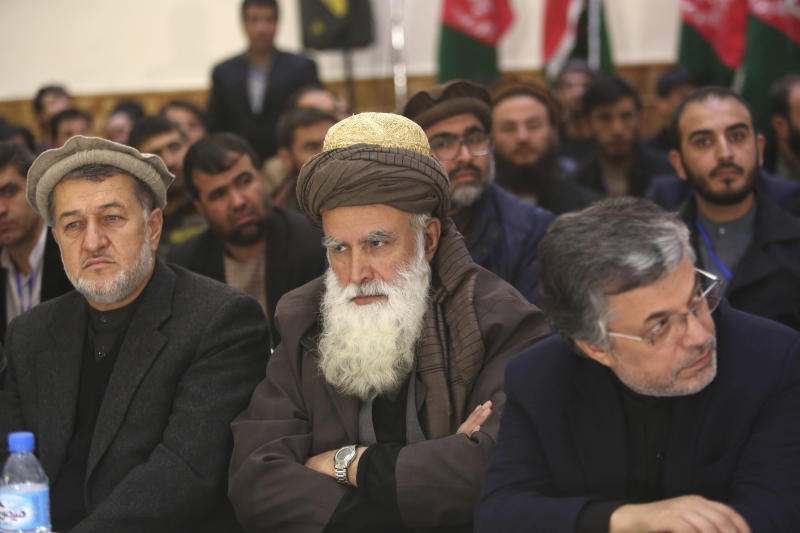 FILE - In this Dec. 18, 2015 file photo, former Afghan warlord Abdul Rasool Sayyaf, center, attends the inauguration of the Afghanistan Protection and Stability Council in Kabul, Afghanistan. Although the Taliban had promised Washington during months of negotiations that the U.S. will never again be attacked from Afghan soil, there's no evidence of a break in relations between long-time allies the Taliban and al-Qaida. Over the years, al-Qaida has had many friends in Afghanistan, some of whom are in high places today, such as  Sayyaf, a powerbroker in Kabul. (AP Photo/Rahmat Gul, File)