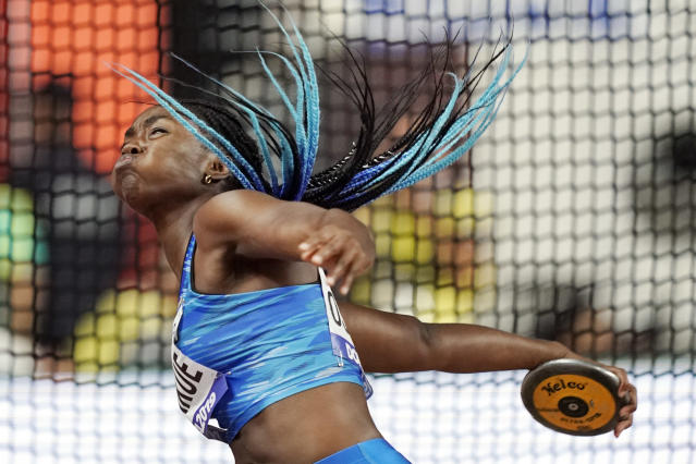 FILE - In this Oct. 2, 2019, file photo, Daisy Osakue, of Italy, competes in the women's discus throw qualifications at the World Athletics Championships in Doha, Qatar. The photo was part of a series of images by photographer David J. Phillip which won the Thomas V. diLustro best portfolio award for 2019 given out by the Associated Press Sports Editors during their annual winter meeting in St. Petersburg, Fla. (AP Photo/David J. Phillip, File)