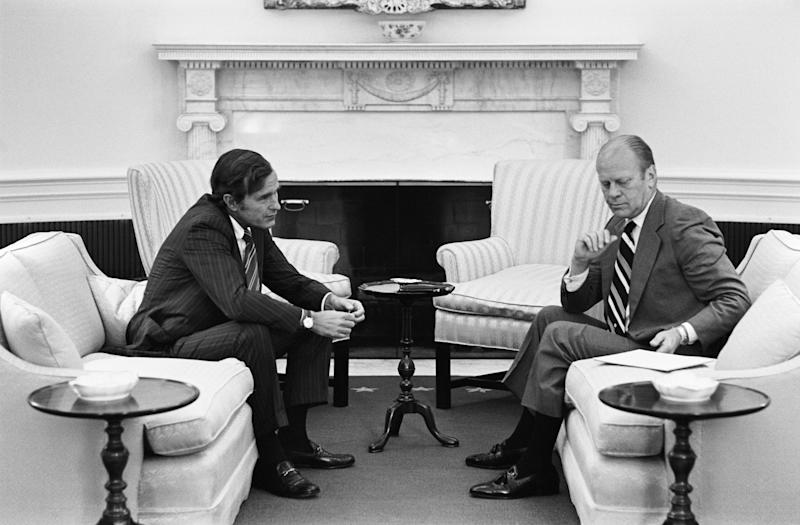 President Gerald R. Ford meets with Republican National Committee Chairman George H.W. Bush in the Oval Office, in 1974.