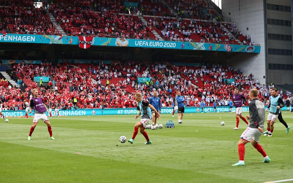 Players of Denmark warm up prior to the UEFA Euro 2020 Championship Group B - Getty Images