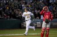 Oakland Athletics Mark Canha runs the bases after hitting a two-run home run against the Los Angeles Angels in the fourth inning of a baseball game, Saturday, March 30, 2019 in Oakland, Calif. (AP Photo/John Hefti)