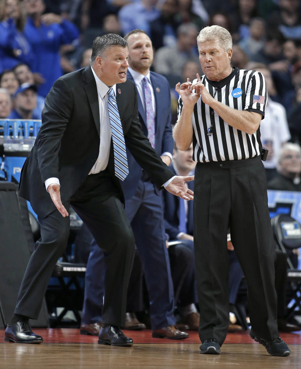 Creighton coach Greg McDermott, left, argues a call during the first half of the team's first-round game against Kansas State in the NCAA men's college basketball tournament in Charlotte, N.C., Friday, March 16, 2018. (AP Photo/Bob Leverone)