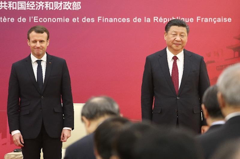 French President Emmanuel Macron and Chinese President Xi Jinping saw eye-to-eye on the battle against climate change, with both voicing their commitment to the Paris accord in the face of US President Donald Trump's pledge to withdraw from the pact (AFP Photo/Ludovic MARIN)