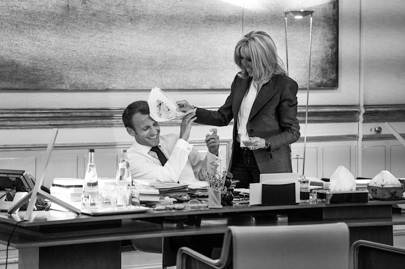 The President and his wife Brigitte share a moment as he wraps up work just before dinner | Christopher Anderson—Magnum Photos for TIME