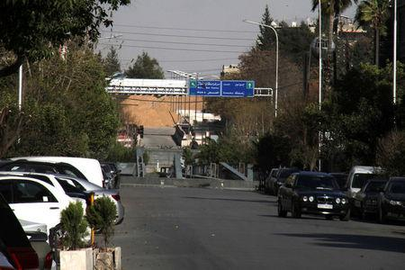 A road sign that shows the direction to Jobar district is pictured in the east of the capital Damascus