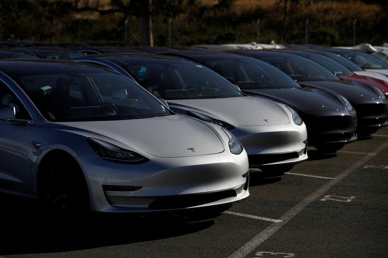 FILE PHOTO: A row of new Tesla Model 3 electric vehicles at a parking lot in Richmond California