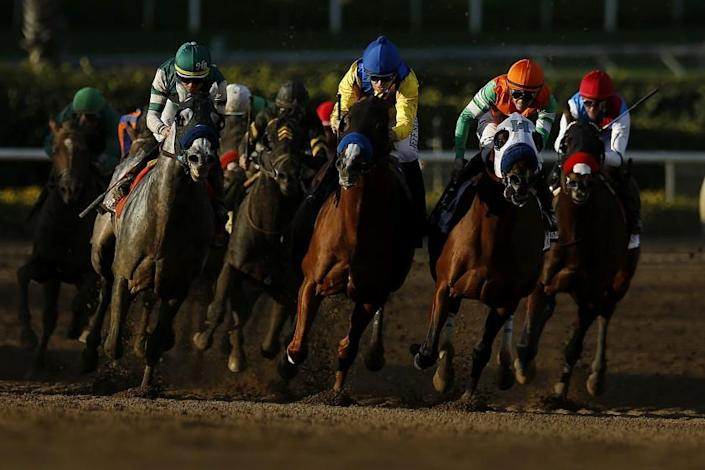 ARCADIA, CALIF. -- WEDNESDAY, DECEMBER 26, 2018: Gift Box (7), left, Dabster (3), center, and Battle of Midway (2), second from right, jockey for position as they head towards the stretch in the San Antonio Stakes (Grade II), eighth race, on Opening Day at Santa Anita Park in Arcadia, Calif., on Dec. 26, 2018. Gift Box went on to win the race. (Gary Coronado / Los Angeles Times)