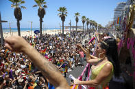 People participate in the annual Pride Parade, in Tel Aviv, Israel, Friday, June 25, 2021. Thousands of people attended the parade on Friday in one of the largest public gatherings held in Israel since the onset of the coronavirus pandemic. (AP Photo/Ariel Schalit)