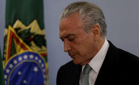 Brazil's President Michel Temer reacts as he speaks at the Planalto Palace in Brasilia