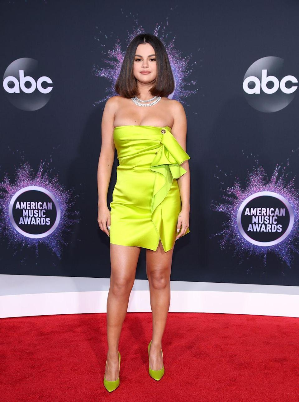 "<p>Attending the 2019 American Music Awards in Los Angeles in a <a href=""https://www.elle.com/culture/celebrities/a29802535/selena-gomez-dress-american-music-awards-2019/"" rel=""nofollow noopener"" target=""_blank"" data-ylk=""slk:strapless Versace"" class=""link rapid-noclick-resp"">strapless Versace</a>.</p>"
