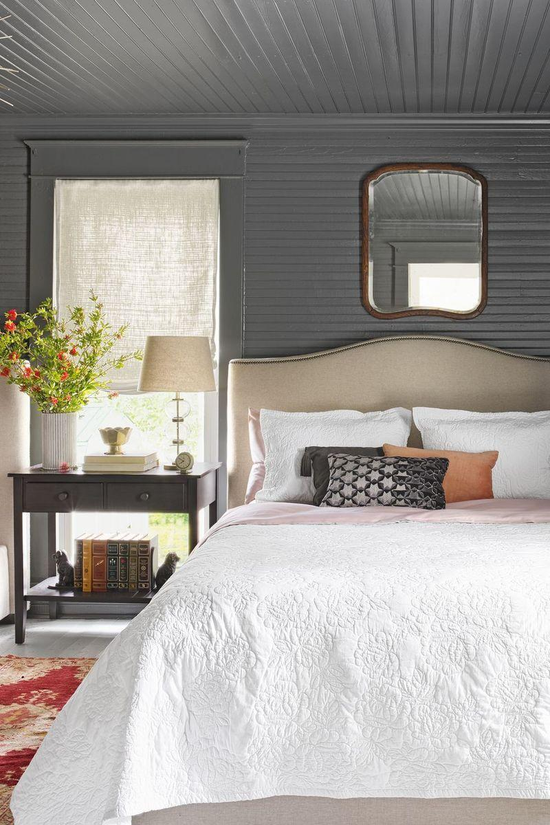 <p>To prevent wood paneling from feeling outdated, go for warm gray paint — the perfect choice to create a calming atmosphere. </p>
