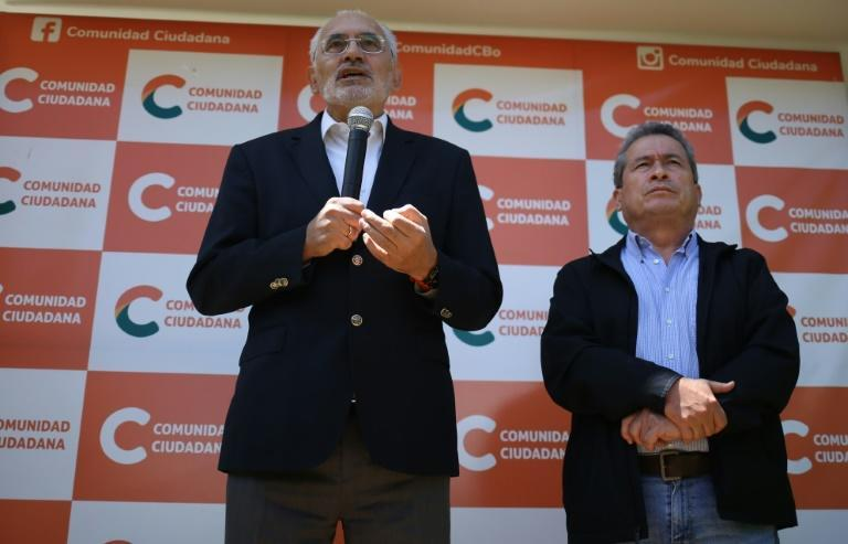Bolivia's centrist presidential candidate, former president (2003-2005) Carlos Mesa (L), conceded after exit polls showed he had been soundly defeated