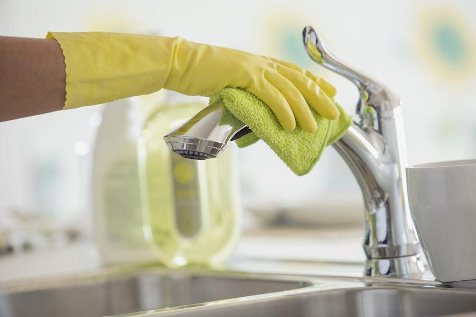 "<p>It's hard to believe, but <a href=""https://www.foodandwine.com/news/science-technology/fyi-your-kitchen-is-probably-dirtier-than-a-toilet-seat"" rel=""nofollow noopener"" target=""_blank"" data-ylk=""slk:your dirty kitchen sink has more bacteria than your toilet seat"" class=""link rapid-noclick-resp"">your dirty kitchen sink has more bacteria than your toilet seat</a>. Miguel Taveras, a supervisor for Managed by Q cleaning service, said he recommends <a href=""https://www.marthastewart.com/1510561/how-serious-deep-clean-kitchen-sink-disposal"" rel=""nofollow noopener"" target=""_blank"" data-ylk=""slk:sanitizing your kitchen sink once a week"" class=""link rapid-noclick-resp"">sanitizing your kitchen sink once a week</a>. For stainless steel, he recommends using an eight-ounce box of baking soda and the juice of 10 limes to create a mildly abrasive paste. As he told <em>Martha Stewart</em>, he uses a sponge to scrub the inside of the sink with it, following the steel's grain. If you have an enamel sink, he recommends using a gentle scrub, such as <a href=""https://www.amazon.com/Bon-Ami-Polishing-Cleanser-Powder/dp/B01LWSJR02"" rel=""nofollow noopener"" target=""_blank"" data-ylk=""slk:Bon Ami Powder Cleanser"" class=""link rapid-noclick-resp"">Bon Ami Powder Cleanser</a>, and a microfiber cloth.</p><p>For garbage disposals, Taveras recommends soaking a loaf of bread with vinegar and stuffing it in the canister. Then, after letting it sit for 15 minutes, turn on the disposal and flush it with cold water. It may sound strange, but it works! </p>"
