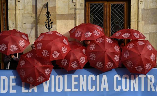 <p>People are covered with red umbrellas to commemorate the victims of gender violence during the UN International Day for the Elimination of Violence against Women in Oviedo, northern Spain, on Nov. 25, 2017. (Photo: Eloy Alonso/Reuters) </p>