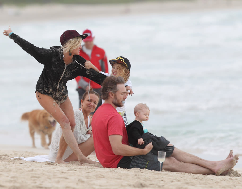 Ashlee Simpson, Bronx and family have a sand fight on the beach in Hawaii. Ashlee and Bronx have a great time throwing sand and playing on the beaches of Hawaii. Pictured: Eric Johnson, Maxwell Johnson, Ashlee Simpson and Bronx Mowgli Wentz Ref: SPL475579  271212  Picture by: Splash News   Splash News and Pictures Los Angeles:310-821-2666 New York:212-619-2666 London:870-934-2666 photodesk@splashnews.com