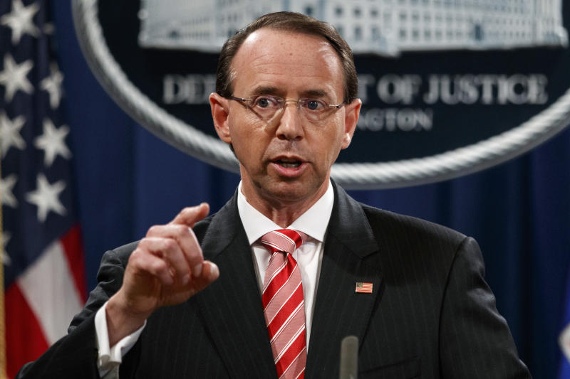 "FILE - In this July 13, 2018, file photo, Deputy Attorney General Rod Rosenstein speaks during a news conference at the Department of Justice in Washington. Rosenstein is denying a report in The New York Times that he suggested last year that he secretly record President Donald Trump in the White House to expose the chaos in the administration. Rosenstein says the story is ""inaccurate and factually incorrect."" (AP Photo/Evan Vucci, File)"