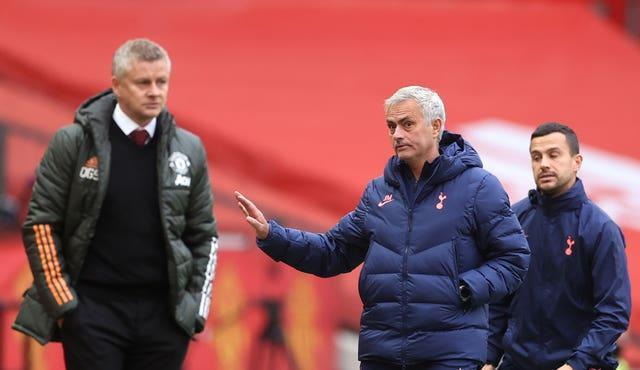 Jose Mourinho, right, has made a dig at his former club Manchester United and manager Ole Gunnar Solskjaer