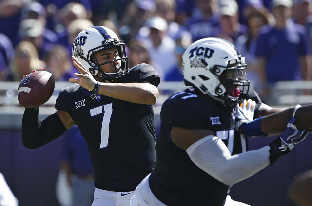 TCU quarterback Kenny Hill (7) passes against West Virginia during the first half of an NCAA college football game Saturday, Oct. 7, 2017, in Fort Worth, Texas. (AP Photo/Ron Jenkins)