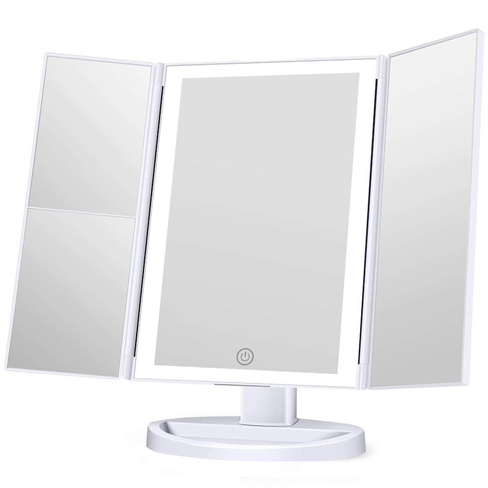 "This trifold LED mirror deserves a special shout-out for all the love it gets on Amazon—it has a stand-out 4.7 out of 5 stars. It's a high-quality, competitively priced, dimmable makeup mirror that gets rave reviews again and again. ""This cosmetic mirror is beautiful. It's lightweight, so easy to move around if needed. It takes four AAA batteries, but also includes a micro USB as another power source…The finish is an exact rose gold color which I love. The 2X and 3X side of the mirror really come in handy. For the price you cannot beat this mirror. I was looking at another more expensive mirror but very glad I went with this one."" <em>—Sheekyna, reviewer on</em> <a href=""https://www.amazon.com/KOOLORBS-Lighting-Magnification-Rotation-Portable/dp/B07XM72TFN/?th=1"" rel=""nofollow noopener"" target=""_blank"" data-ylk=""slk:Amazon"" class=""link rapid-noclick-resp""><em>Amazon</em></a> $25, Amazon. <a href=""https://www.amazon.com/KOOLORBS-Lighting-Magnification-Rotation-Portable/dp/B07XM72TFN/ref=asc_df_B07XM72TFN/"" rel=""nofollow noopener"" target=""_blank"" data-ylk=""slk:Get it now!"" class=""link rapid-noclick-resp"">Get it now!</a>"