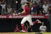 The ball goes by Los Angeles Angels' Brandon Marsh before he scores on a three RBI double by Jack Mayfield during the seventh inning of a baseball game against the Houston Astros Wednesday, Sept. 22, 2021, in Anaheim, Calif. (AP Photo/Mark J. Terrill)