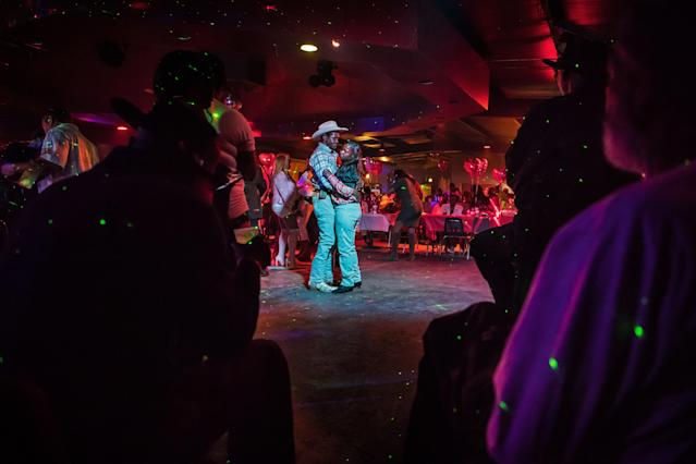 "<p>Joe ""Dancing Cowboy"" Wrenn and his wife Barbara dance on ""Cowboy Night"" at Club Black Castle in Ruleville, Miss., February 2018. (Photograph by Rory Doyle) </p>"