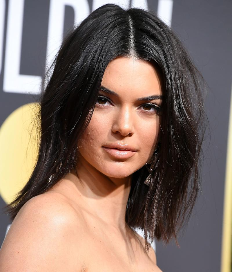 Model Kendall Jenner, pictured at the Golden Globes with some blemishes, just got more beautiful in the eyes of some fans for encouraging them to not let acne in the way. (Steve Granitz via Getty Images)