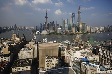 A general view of the Shanghai's financial district of Pudong, with the Shanghai Tower (R), which is undergoing construction and scheduled to finish by the end of 2014, in Shanghai July 31, 2013. REUTERS/ Carlos Barria