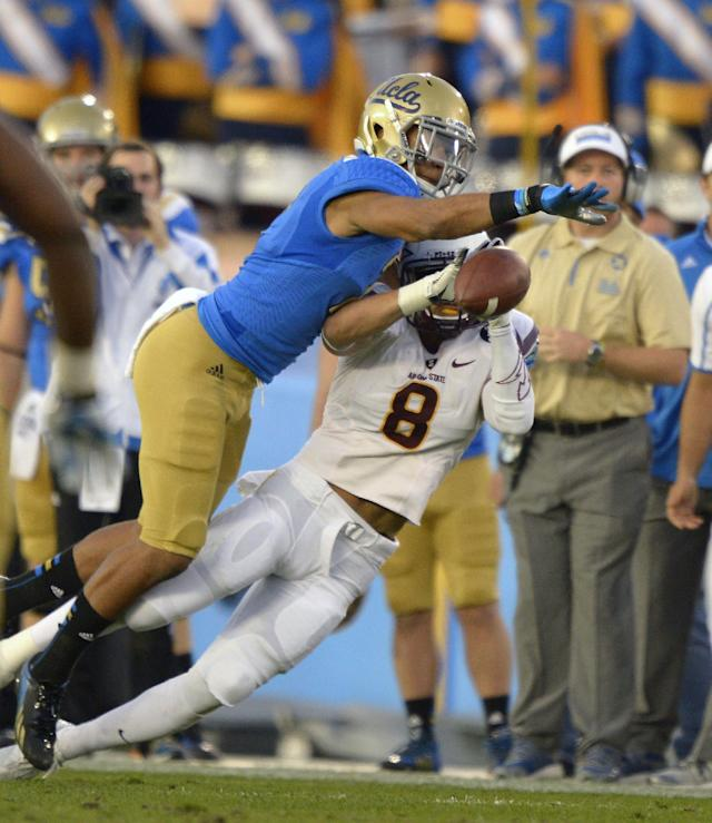 UCLA defensive back Priest Willis, left, knocks down a pass intended for Arizona State running back D.J. Foster during the first half an NCAA college football game, Saturday, Nov. 23, 2013, in Pasadena, Calif. (AP Photo/Mark J. Terrill)