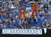 Fans pay tribute to New York Mets pitcher R.A Dickey, who is going for his 20th victory, during a baseball game against the Pittsburgh Pirates at Citi Field in New York, Thursday, Sept. 27, 2012. (AP Photo/Kathy Willens)
