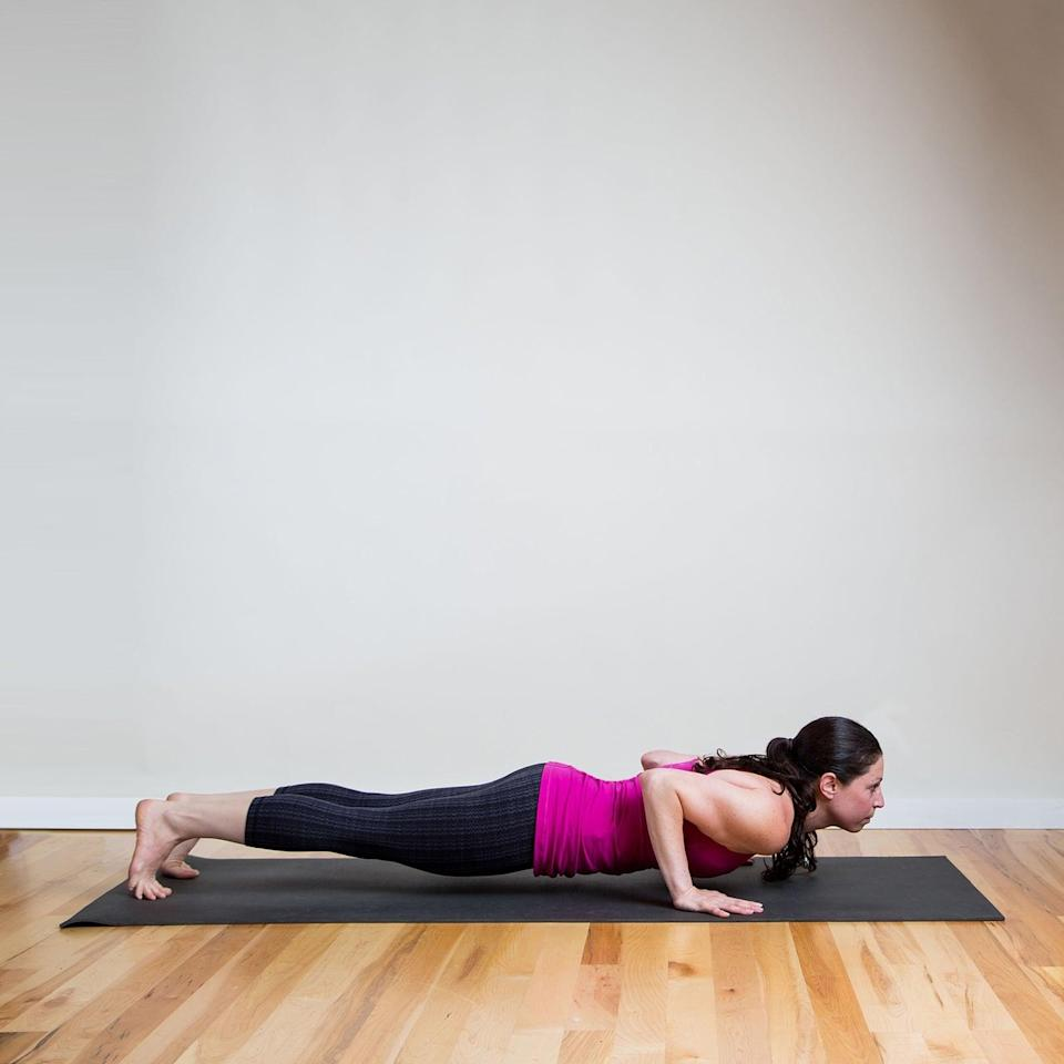 <p><strong>Sanskrit Name:</strong> Chaturanga Dandasana </p> <p><strong>English Translation:</strong> Four-Limbed Staff Pose </p> <ul> <li>Begin at the front of your mat in Mountain Pose. Inhale to raise your arms up and exhale to fold forward into Standing Forward Bend. Inhale, straighten your arms and back, and look up. As you exhale, step or jump both feet back (so you're in a push-up position) and bend your elbows straight behind you, brushing them against the sides of your body, lowering into Four-Limbed Staff.</li> <li>Keep your body parallel to the ground and your shoulders parallel with your elbows. Draw your navel toward your spine to protect your lower back, holding for five breaths.</li> </ul>