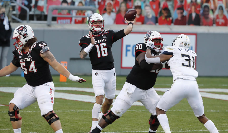 North Carolina State quarterback Bailey Hockman (16) throws a pass during the first half of the team's NCAA college football game Georgia Tech in Raleigh, N.C., Saturday, Dec. 5, 2020. (Ethan Hyman/The News & Observer via AP, Pool)