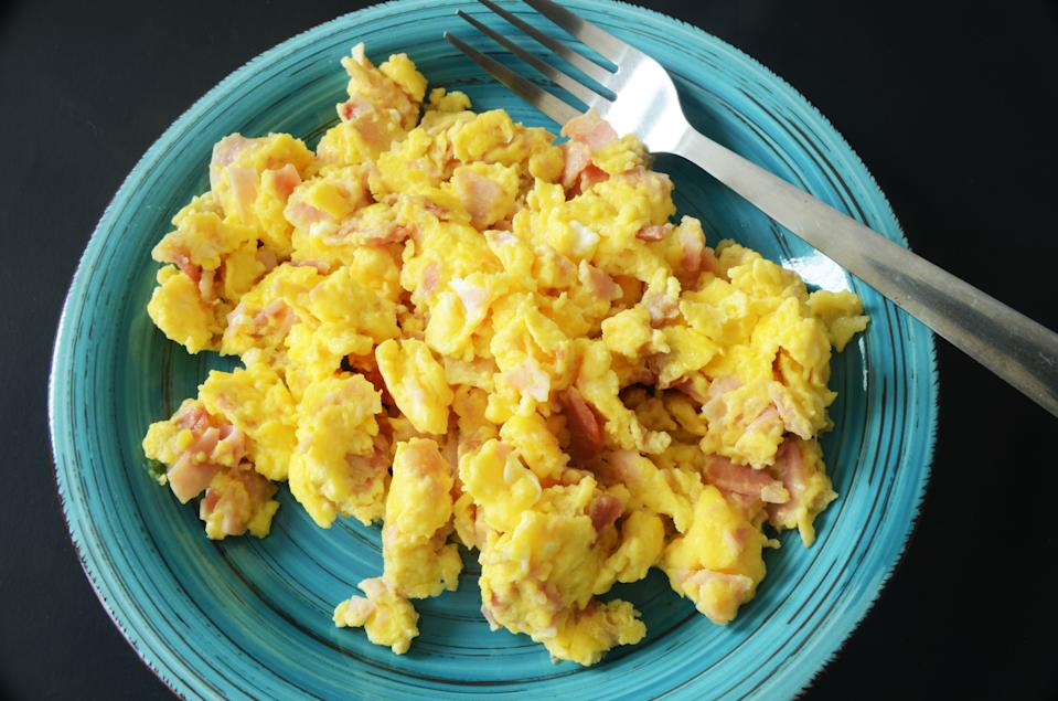 close up of scramble eggs with ham breakfast