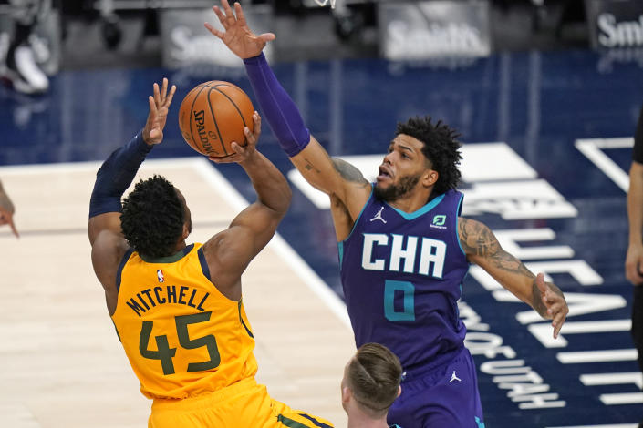 Utah Jazz guard Donovan Mitchell (45) shoots as Charlotte Hornets forward Miles Bridges (0) defends in the second half during an NBA basketball game Monday, Feb. 22, 2021, in Salt Lake City. (AP Photo/Rick Bowmer)