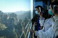 The three double-decker elevators in central China's Zhangjiajie Forest Park zip up the cliff in just 88 seconds