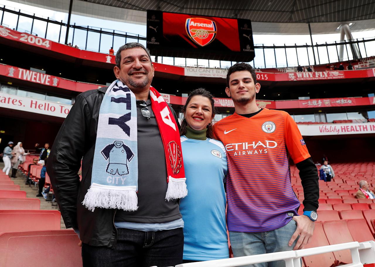 Matthaus Martins Fontes (R), a student from Ji-Parana in Brazil, poses for a photograph with his parents, Lucio (L) and Sandra, at a Premier League soccer match between Arsenal and Manchester City in London, Britain, April 2, 2017. Picture taken April 2, 2017. REUTERS/Eddie Keogh