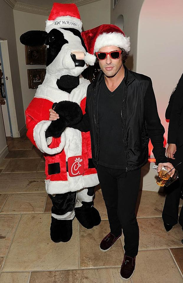 Fellow rich kid/party boy Brandon Davis got into the holiday spirit and even made friends with a festive cow. (12/07/2011)